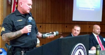 Camden County Bomb Squad Sgt. Brian Madison holds up an inert pipe bomb used as a training device. Credit: Matt Skoufalos.