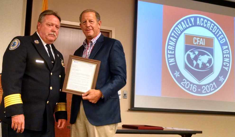 Cherry Hill Fire Chief Thomas Kolbe presents Cherry Hill Mayor Chuck Cahn with a plaque for the department's ISO-I classification. Credit: Matt Skoufalos.