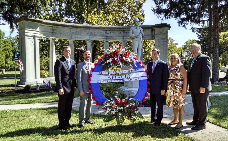 Labor organizers and elected officials gather at the gravesite of Peter J. McGuire in Pennsauken. Credit: Matt Skoufalos.