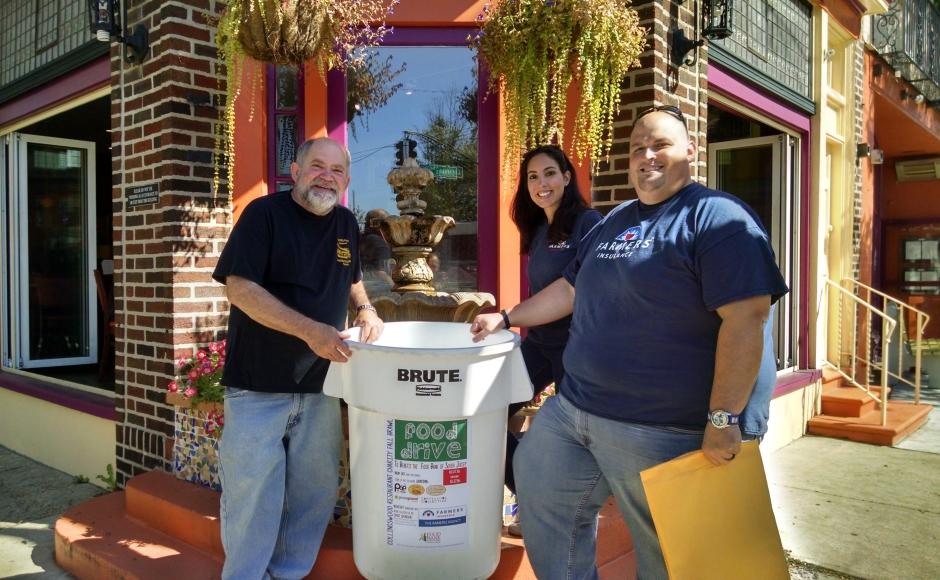 Tortilla Press owner Mark Smith (left) with Talley and Rameriz. Credit: Matt Skoufalos.