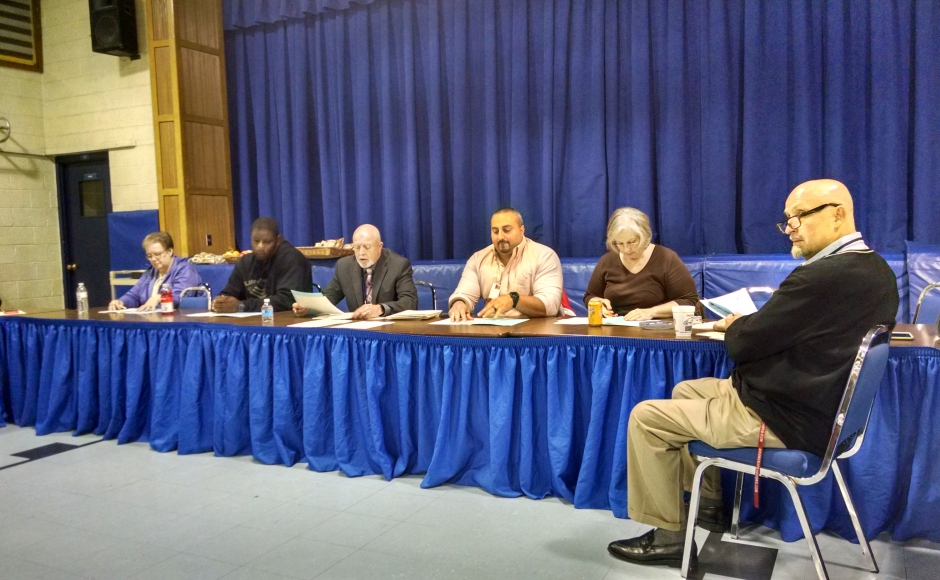 Woodlynne Board of Education, with McCulley (third from left) and Tarchichi (third from right). Credit: Matt Skoufalos.