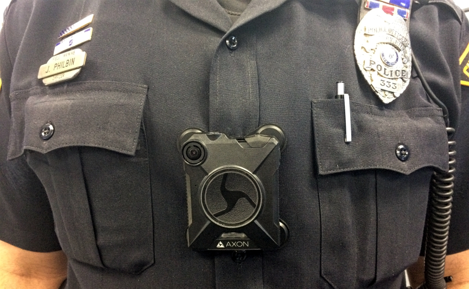 Cherry Hill Police Community Relations Officer Jim Philbin displays one of the newly issued body cameras. Credit: Cherry Hill Police.