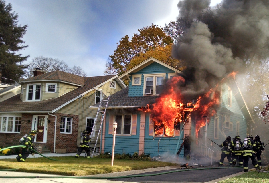 Firefighters battle a house fire on Eldridge Avenue in Collingswood. Credit: Matt Skoufalos.