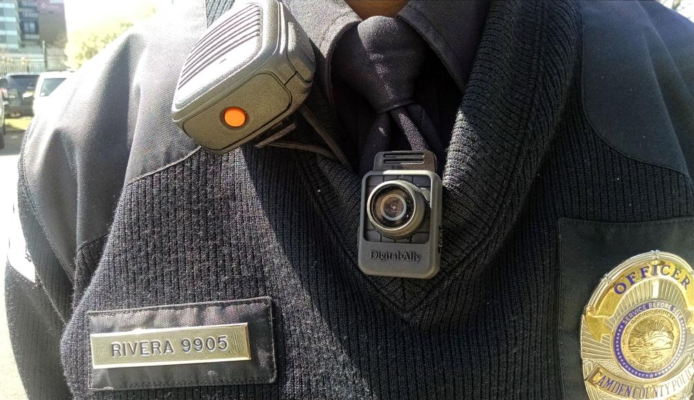 CCPD Officer Vidal Rivera displays his body camera. Credit: Matt Skoufalos.