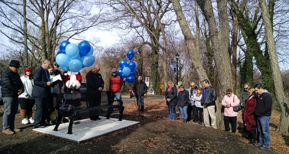 Pastor Luis Lopez leads a prayer at the dedication of a bench to Brendan Creato. Credit: Matt Skoufalos.