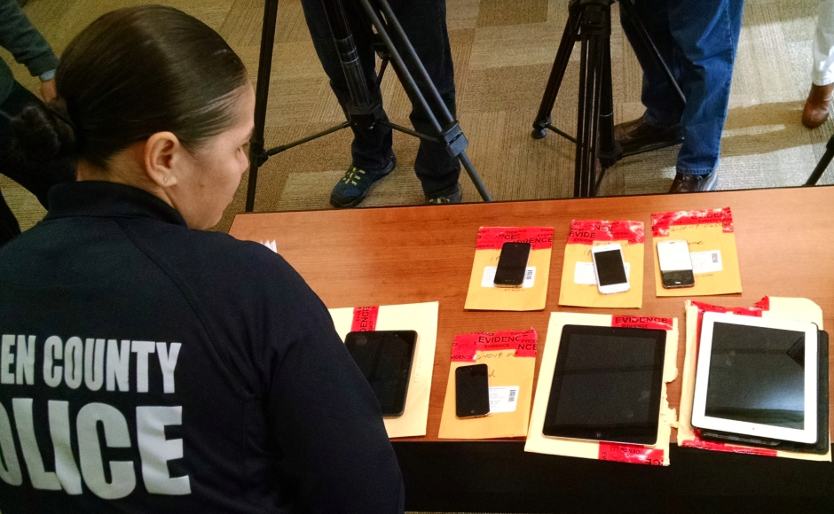 CCPD Sgt. Janell Simpson displays recovered electronics. Credit: Matt Skoufalos.